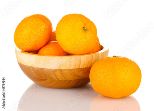 Tasty mandarines  in wooden bowl isolated on white
