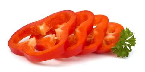 Cut sweet red peppers isolated on white