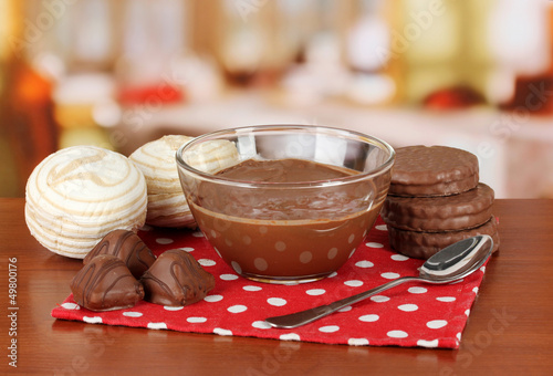 Bowl of chocolate and sweets on table in cafe