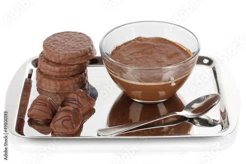 Bowl of chocolate and sweets isolated on white