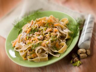 pasta with salmon pistachio and cream sauce, selective focus