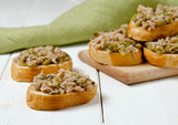 Tuna on bread with capers and cornichons