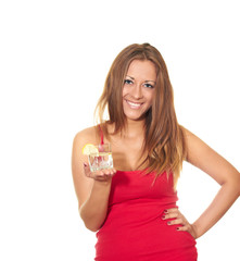 attractive girl in a red shirt holding a glass with a drink