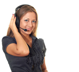 attractive girl in a black blouse with a microphone and headphon