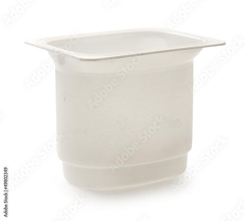 Empty plastic yoghurt pot on white