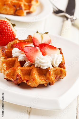 belgian waffles with fresh strawberries and whipped cream