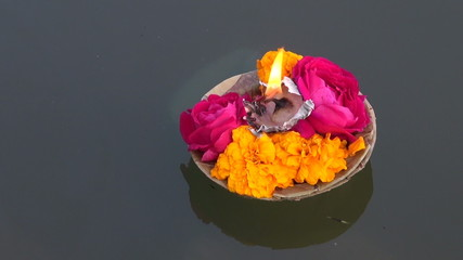 hinduism religious ceremony puja flowers and candle on Ganges