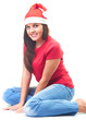 Attractive smiling young woman in a red shirt and a Christmas ha