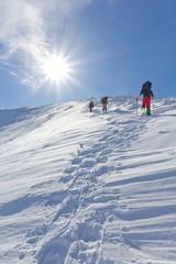 hikers walk upwards