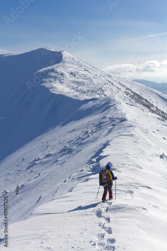 hiker walk by a mountain ridge