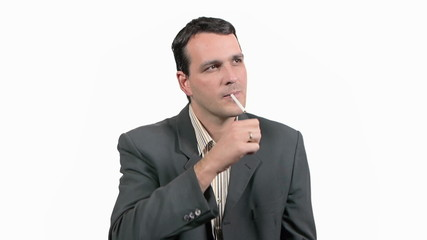 Businessman thinking and lighting up cigarette