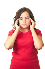 Attractive girl in red shirt is suffering from pain in the head.