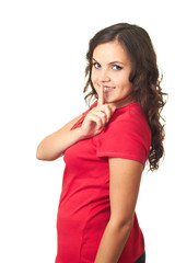 Attractive girl in red shirt making a keep it quiet gesture.