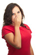 Attractive girl in a red shirt from the stench covers the nose.