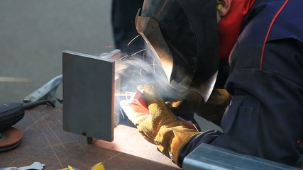 Industrial worker in welding process