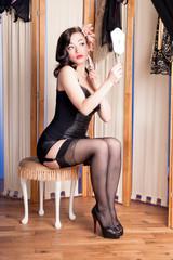 Burlesque beauty in black lingerie in boudoir