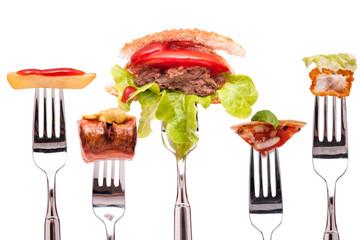 Fastfood auf einer Gabel