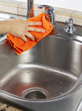 Female hand Drying Kitchen Sink