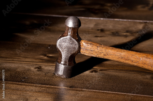 Old hammer on a wooden floor