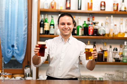 Bartender offering beers