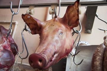 pig cut head in a meat market