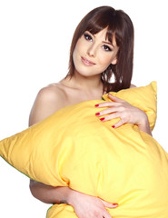 young woman hugging her pillow
