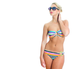 Blonde girl in striped bikini and sunglasses