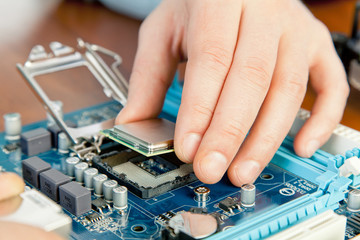 Technician repairing computer hardware in the lab