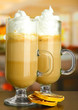 Fragrant coffee latte in glasses cups with dry orange,