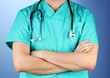 Doctor with stethoscope, on blue background