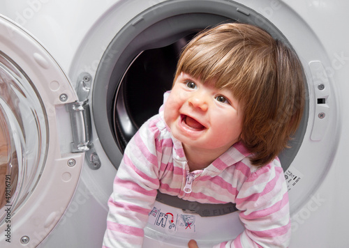 baby girl in the washing machine
