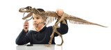 Little boy looking at dinosaur with magnifier isolated