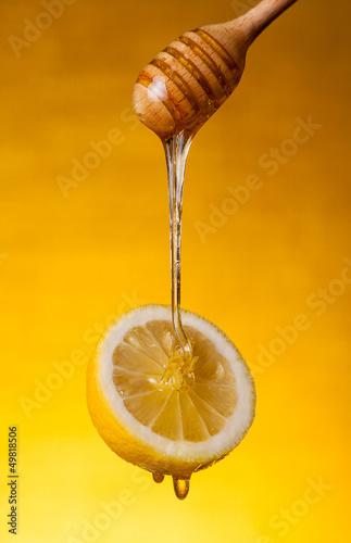Honey flowing on lemon