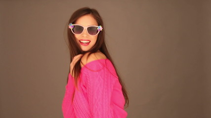 Brunette woman with sunglasses holding her hair