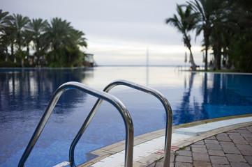 It is a very blue water pool.