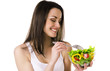 Beautiful young girl eats salad