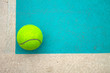 A tennis ball on court