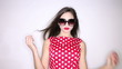 Beautiful young woman in red polka dots dress isolated on