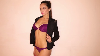 Portrait of a woman in sexy lingerie and black blazer