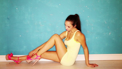 Full length portrait girl sitting wear pink high heel shoes