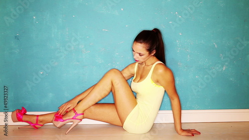 Full length portrait girl sitting wear pink high heel shoes