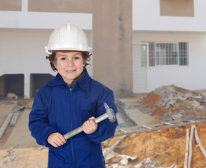 Happy little boy with a hammer