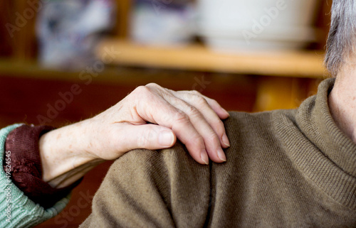 woman's hand on man's shoulder