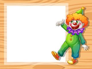 A clown beside an empty white board