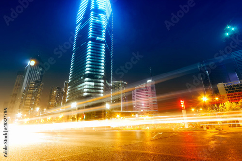 the light trails on the modern building background in shanghai c