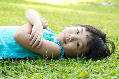 Child lying on grass