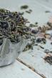 Dry green tea leaves in a rustic metal cupcake