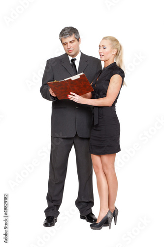 Businesswoman showing the checklist to businessman