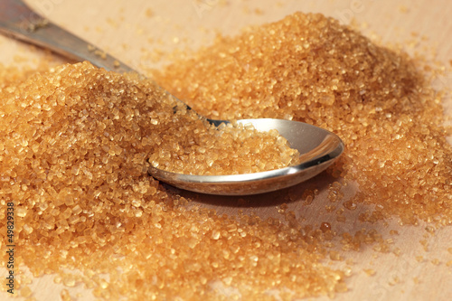 Raw brown sugar with a spoon