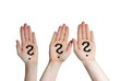 three hands with question marks